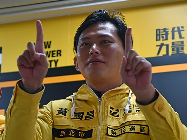 Huang Kuo-chang, an academic and leader of the Sunflower Movement, gestures during a press conference in Taipei. AFP