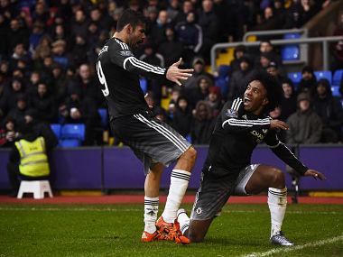 Willian celebrates with Diego Costa after scoring the second goal for Chelsea. Reuters.