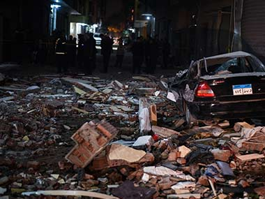 Damaged cars are seen at the scene of a bomb blast in Giza. AFP