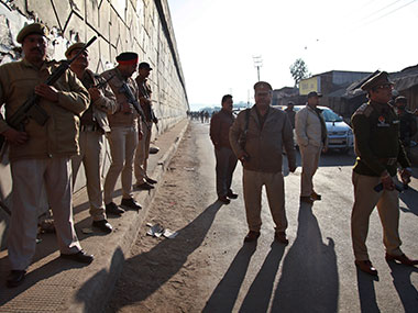 Police officers stand in guard near the area of the attack in Pathankot. AFP