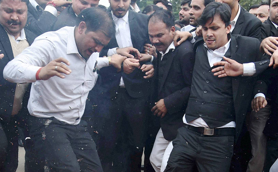 Lawyers burn an effigy as they march from Patiala House Courts to India Gate against alleged 'anti-national' activities at JNU in New Delhi on Friday. PTI