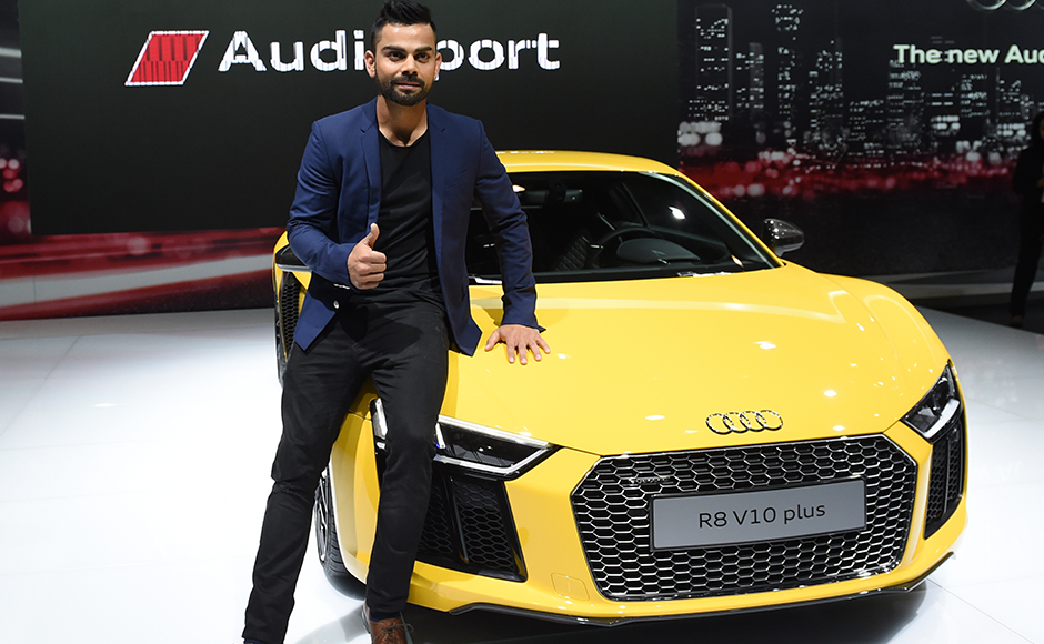 Indian cricketer Virat Kohli poses with the newly launched Audi R8 V10 plus at the Indian Auto Expo 2016 in Greater Noida on the outskirts of New Delhi. AFP/Sajjad Hussain