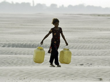 A village girl carries empty containers to collect drinking water near Chilla village in the Bundelkhand region of Uttar Pradesh in a file photo. Reuters