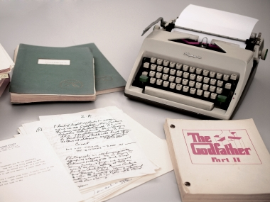 Mario Puzo's 1965 Olympia typewriter with manuscripts and versions of both Godfather I and II screenplays. AP