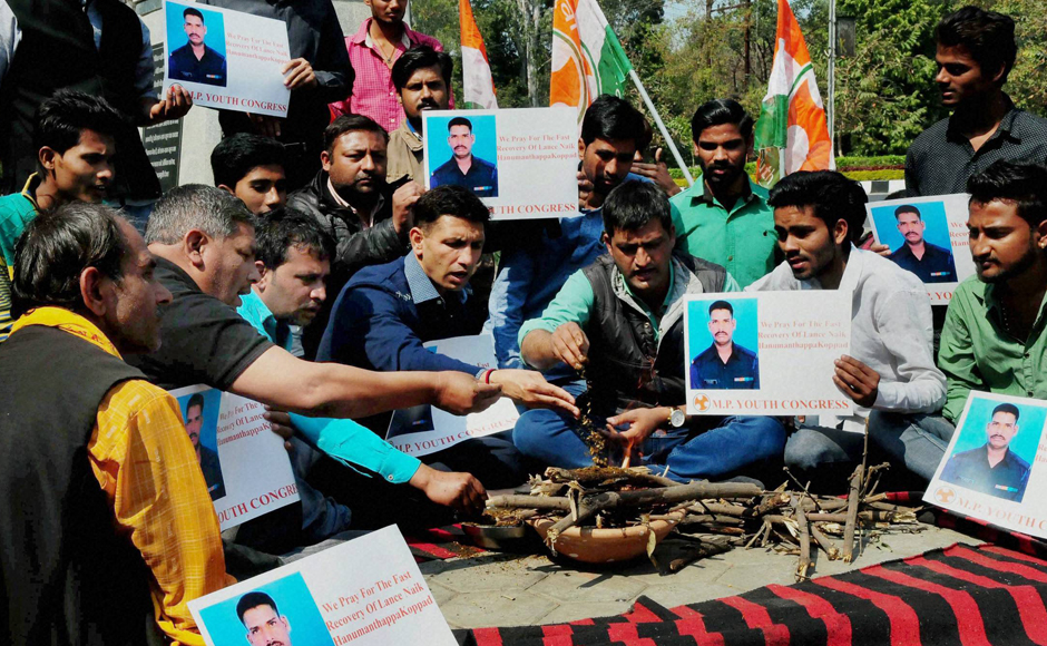 Youth Congress workers performing hawan for speedy recovery of Siachen miracle soldier Lance Naik Hanumanthappa Koppad in Bhopal on Wednesday.PTI
