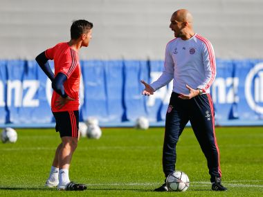 Bayern Munich's coach Pep Guardiola and Xabi Alonso during training ahead of Champions League match against Juventus. Reuters