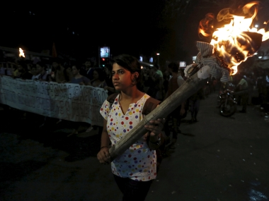 A student holds a torch during a rally to protest against the arrest of a student of Jawaharlal Nehru University (JNU), outside the Jadavpur University campus. Reuters