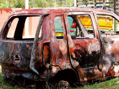 The car which was burnt in Bengaluru. Image courtesy: Twitter