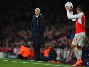Arsene Wenger looks on as Alexis Sanchez readies a throw. Arsenal lost 2-0 to Barcelona in the first leg of Champions League Round of 16 tie. Getty