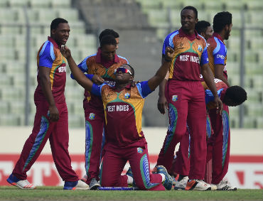 West Indies cricketers after winning the U19 World Cup title in Dhaka on Sunday. AFP