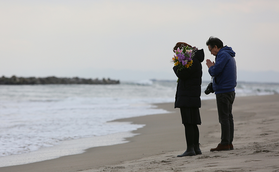 People offer prayers at Fukanuma beach on Friday in Sendai, Japan. Today Japan marked the fifth anniversary of the 2011 tsunami that killed more than 18,000 people and the subsequent damage to the reactors at TEPCO's Fukushima Daiichi Nuclear Power Plant. Getty Images