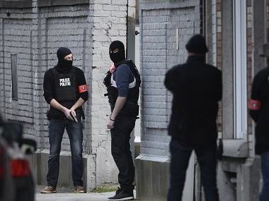 Police officers stand at the site of the shooting on Dries-Driesstraat at Forest-Vorst in Brussels. AFP