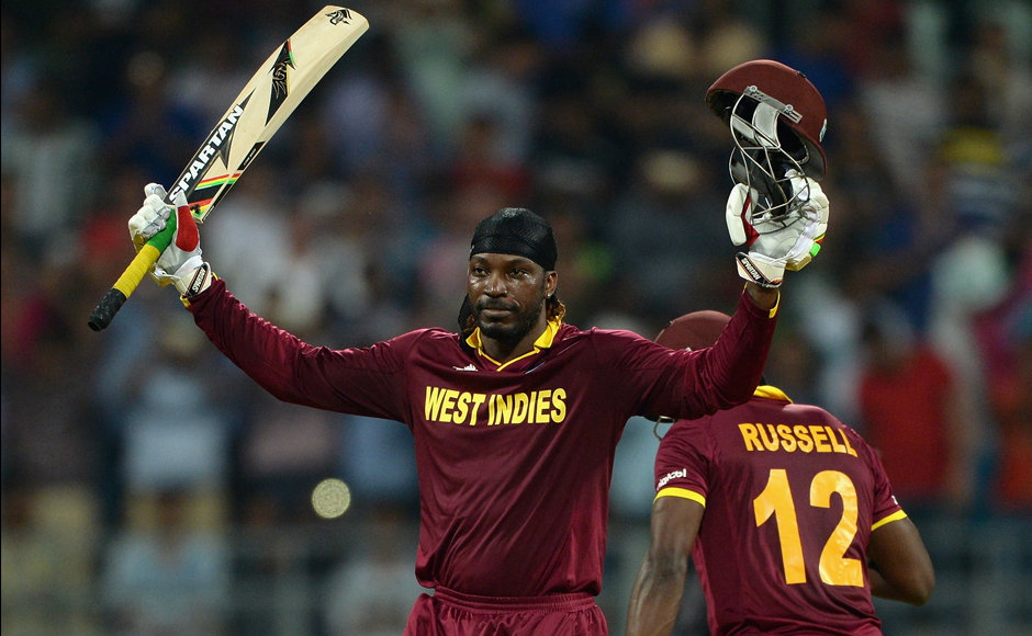 Chris Gayle celebrates after reaching his century in 47 deliveries. Getty Images