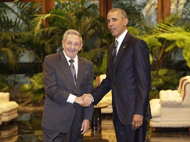 Cuban President Raul Castro, left, shakes hands with US President Barack Obama during a meeting in Revolution Palace on Monday. AP