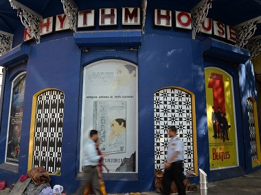 Pedestrians walk past the iconic Rhythm House music store in Mumbai. AFP