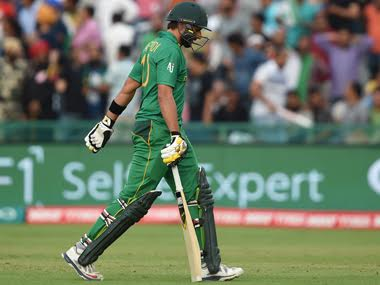 Shahid Afridi walks back to the pavillion after being dismissed against Australia. AFP