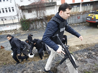 Special forces officers conduct a search operation following the attack on the police station in Istanbul. Reuters