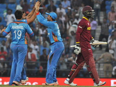Afghanistan players celebrate the wicket of West Indies captain Darren Sammy during the World T20 match in Nagpur on Monday. Solaris Images