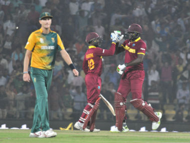 West Indies players Carlos Brathwaite and Denesh Ramdin celebrate after winning their World T20 match against South Africa in Nagpur on Friday. Solaris Images