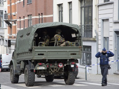 A file image of a truck carrying soldiers of the Belgian Army arriving at the metro station in Brussels after the 22 March attack. AP