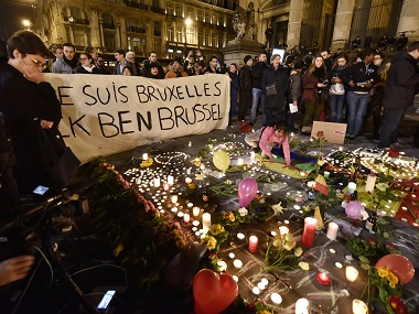 People mourning the victims of the attacks in Brussels. AP