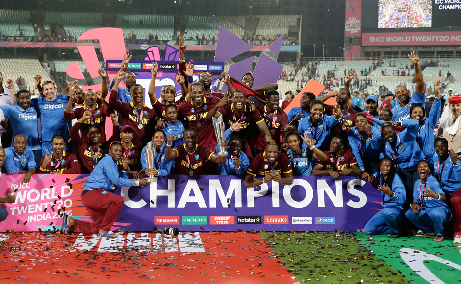 Champions: The West Indies men's and women's team pose with their ICC World T20 trophies after completing the rare 'Dream Double'. AP