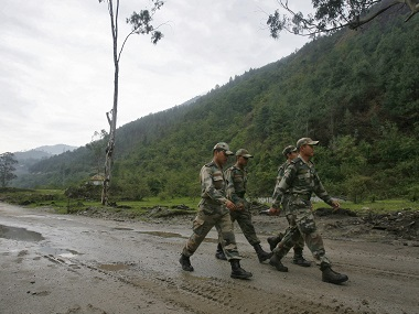 Indian army soldiers march near an army base on India's Tezpur-Tawang highway, which runs to the Chinese border, in Arunachal Pradesh. File photo Reuters