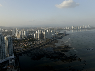 "The setting sun lights up the Panama City skyline, Monday, April 4, 2016. Panama's President  Juan Carlos Varelasays says his government will cooperate ""vigorously"" with any judicial investigation arising from the leak of a vast trove of information on the offshore financial dealings of the world's rich and famous. An international coalition of media outlets Sunday published investigations it said stemmed from the leak of 115 million records kept by the Panama-based law firm Mossack Fonseca on behalf of clients. (AP Photo/Arnulfo Franco)"