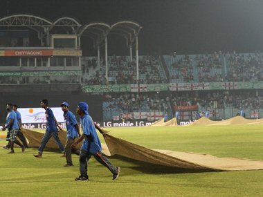 Ground staff wipe the dew from the grounds during a ICC World Twenty20 match. Getty Images