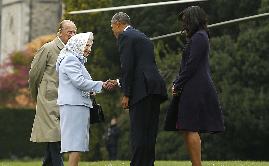 President Barack Obama and his wife first lady Michelle Obama are greeted by Britain's Queen Elizabeth II and Prince Philip after landing by helicopter at Windsor Castle for a private lunch in Windsor, Britain. Reuters