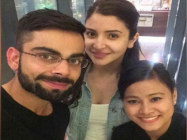 Virat Kohli and Anushka Sharma with the fan