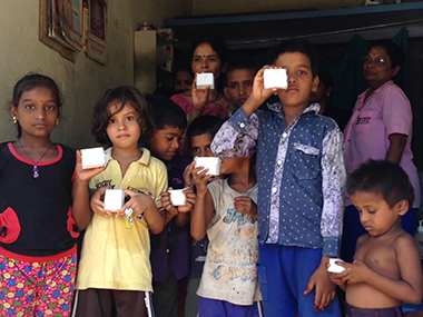 Children pose for a photo after receiving their recycled soaps