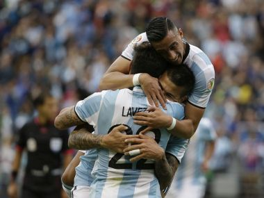 Argentina's Victor Cuesta congratulated by Ezequiel Lavezzi and Ramiro Funes Mori after scoring his side's third goal against Bolivia. AP