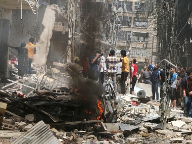 People inspect the damage at a site hit by airstrikes, in the rebel-held area of Aleppo's Bustan al-Qasr. File photo Reuters