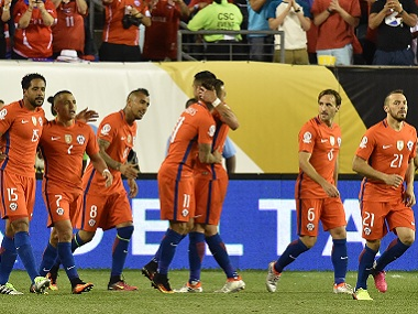 Chile players celebrate with teammates after scoring against Panama during their Copa America match. AFP