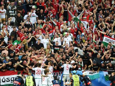 Hungary's players celebrate with fans after their win over Austria. AFP