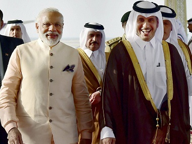 Prime Minister Narendra Modi  with his Qatar counterpart Emir of Qatar Abdullah bin Nasser bin Khalifa Al Thani during arrival at Doha airport on Saturday.   PTI