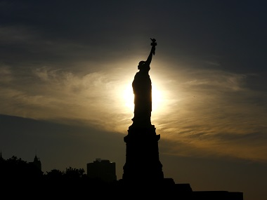 The sun rises behind the Statue of Liberty a day before the United States celebrates its independence on Sunday. AP