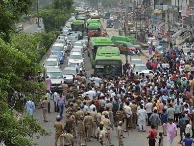 AAP workers block traffic in New Delhi to protest the arrest of party MLA Amanatullah Khan on Sunday. PTI