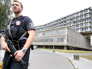 A police officer secures the entry to Berlin's Benjamin Franklin hospital. DPA