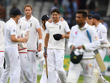 England captain Alastair Cook is congratulated by team mates after win over Pakistan in 2nd Test. Getty