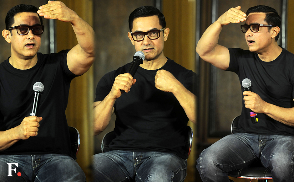 Amir Khan launched the poster of his film 'Dangal' at an event in Mumbai on Monday, 4 July 2016. Aamir plays Mahavir Singh Phogat in the movie, which traces how Phogat trained his daughters Geeta and Babita to become medal-winning wrestlers. Image bySachin Gokhale/Firstpost