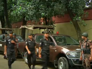 Police gather after gunmen attacked the Holey Artisan restaurant in Dhaka. Reuters
