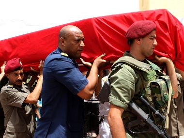 Members of the Tunisian army carry the coffin of Tunisian military doctor Fathi Bayoudh during his funeral in his home town of Ksour Essef, south of Tunis. AFP