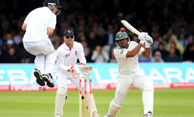 Wahab Riaz hits out watched by wicketkeeper Matt Prior as Jonathan Trott takes evasive action during Test Match in 2010. Getty