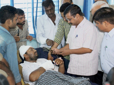 Delhi CM Arvind Kejriwal along with AAP volunteers visiting the Dalit member who consumed poison in protest against assault on Dalit members by cow protectors few days back, at a hospital in Rajkot on Friday. PTI