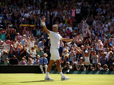 Roger Federer celebrates victory against Marin Cilic at Wimbledon. Getty