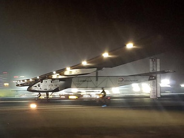 The Solar Impulse 2 plane lands in an airport in Abu Dhabi, United Arab Emirates, early Tuesday, July 26, 2016, marking the historic end of the first attempt to fly around the world without a drop of fuel, powered solely by the sun's energy. Solar Impulse Chairman and pilot Bertrand Piccard was at the controls of the single-seater when it landed at the Al Bateen Executive Airport. Piccard traded off piloting with co-founder Andre Borschberg in the epic journey that took more than a year to complete. (AP Photo/Aya Batrawy)