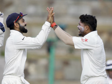 Umesh Yadav celebrates a dismissal with skipper Virat Kohli. AP