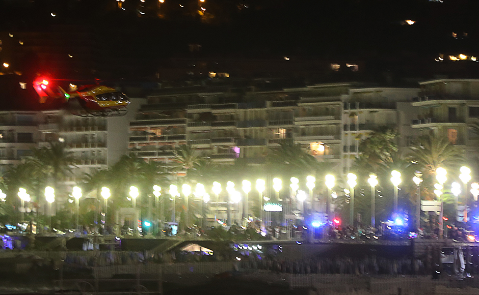 """Up to 80 people are feared dead after a van drove into a crowd watching Bastille Day fireworks in the French resort of Nice on 14 July, an official announced. The attack has been described as a """"major criminal attack"""". AFP"""